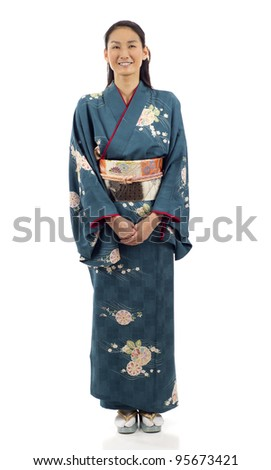 Full length of a smiling Japanese kimono woman standing isolated over white background - stock photo