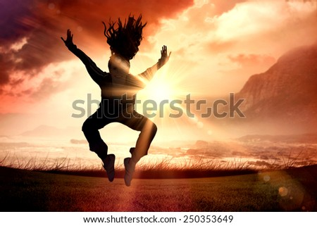 Full length of a sporty young blond jumping against sunrise over magical sea - stock photo