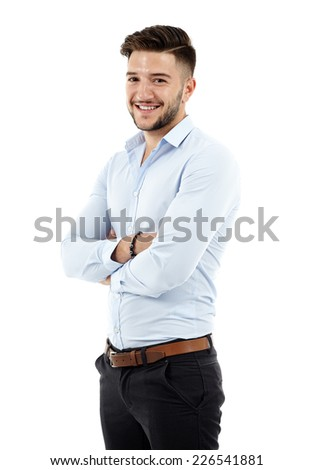 Full length of a young caucasian businessman with arms folded