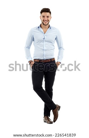 Full length of a young caucasian businessman with hands in his pockets - stock photo