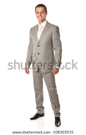 Full length of a young man in a suit smiling brightly, over white background