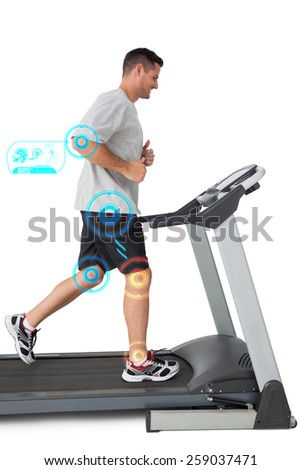 Full length of a young man running on a treadmill against fitness interface