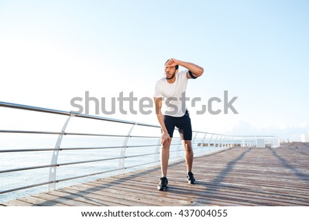 Man standing on pier looking away stock photo 193850906 for Terrace jogging track