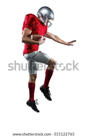 Full length of American football player defending against white background