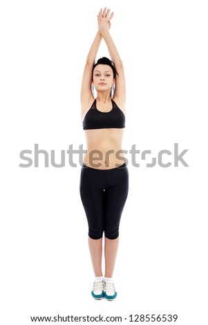 Full length of an athletic young woman exercising, isolated on white - stock photo