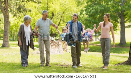Full length of an extended family playing in the park - stock photo