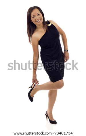 Full length of Asian woman putting her shoe on isolated over white background - stock photo