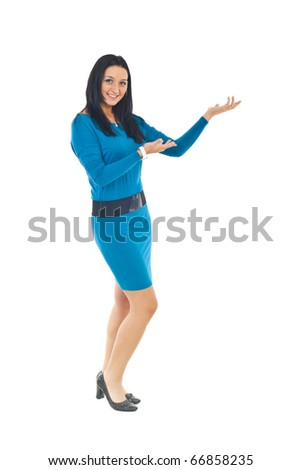 Full length of attractive woman in blue tight dress making presentation to copy space isolated on white background - stock photo