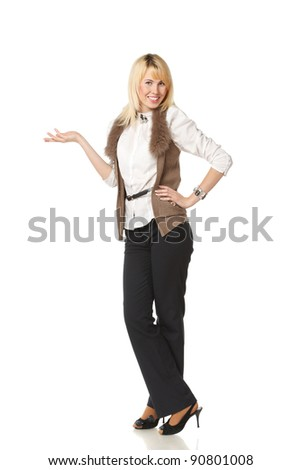 Full length of beautiful blond business woman showing copy space over white background - stock photo