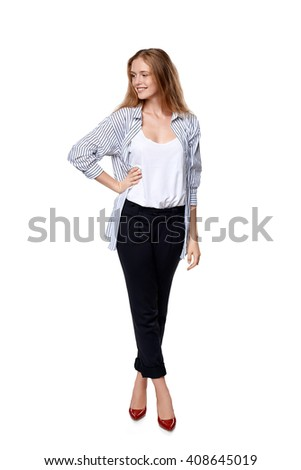 Full length of beautiful blond female fashion model posing over white background looking to the side at blank copy space - stock photo