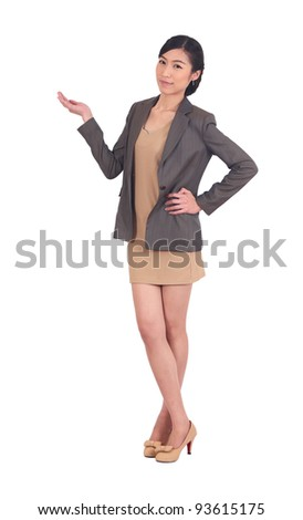 Full length of beautiful business woman holding and presenting isolated. - stock photo