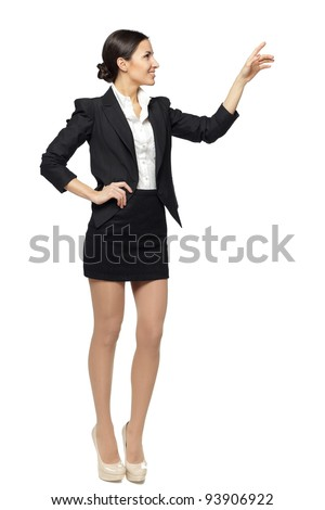 Full length of beautiful  business woman showing copy space over white background - stock photo