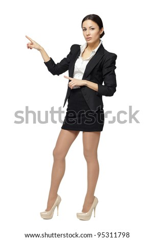 Full length of beautiful business woman showing copy space with both hands, over white background