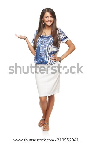 Full length of beautiful elegant woman showing holding on the palm blank copy space over white background - stock photo