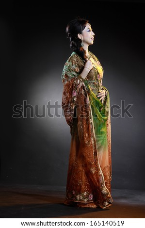 Full length of beautiful female wearing traditional indian costume posing  - stock photo