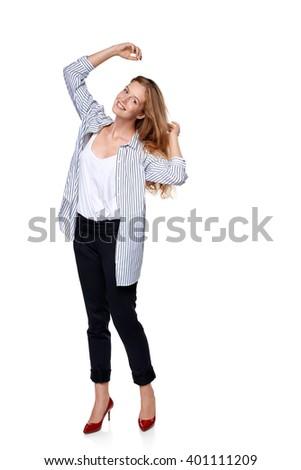 Full length of beautiful playful blond fashion model posing over white background  - stock photo