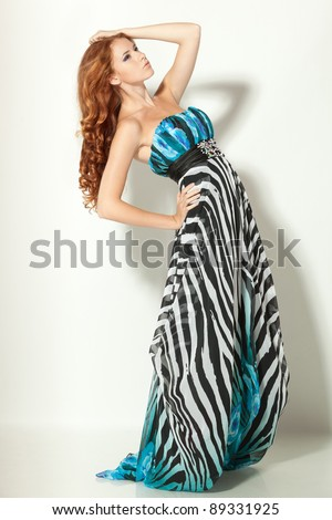 Full length of beautiful red-haired fashion model posing - stock photo