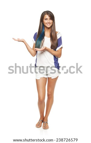 Full length of beautiful tanned woman in shorts showing holding on the palm blank copy space over white background - stock photo