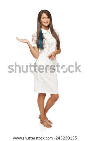 Full length of beautiful woman in white dress showing holding on the palm blank copy space over white background - stock photo
