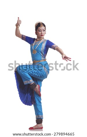 Full length of Bharatanatyam classical dancer performing over white background - stock photo