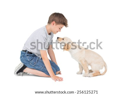 Full length of boy with dog over white background - stock photo