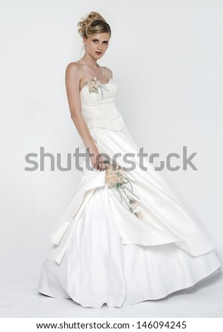 Full length of bride wearing luxurious wedding dress  - stock photo