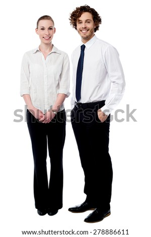 Full length of business couple posing together - stock photo