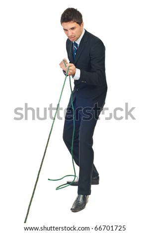 Full length of business man trying hard to pulling rope isolated on white background - stock photo