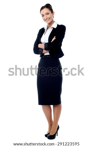 Full length of business woman keeping her arms folded - stock photo