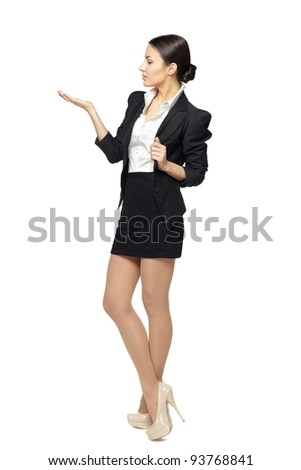 Full length of business woman looking at blank copy space on her palm - empty space for product or text, isolated on white background - stock photo