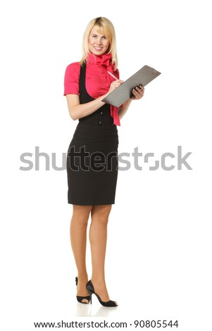 Full length of business woman making notes on a clipboard, isolated on white background
