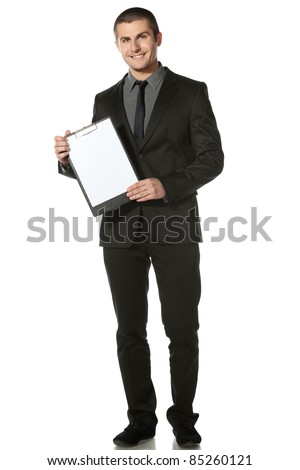 Full length of businessman holding blank board, isolated on white background - stock photo