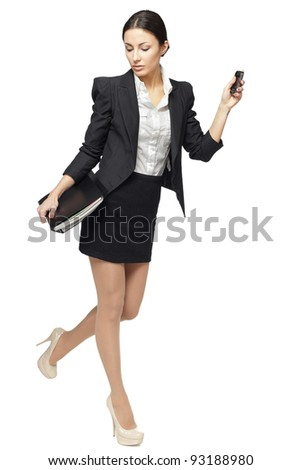 Full length of businesswoman hurrying, isolated on white background - stock photo