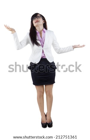 Full length of businesswoman juggling gesture, isolated on white background - stock photo