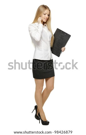 Full length of businesswoman walking talking on mobile phone, isolated on white background - stock photo
