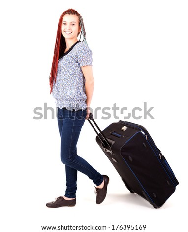 Full length of casual woman with the heavy travel suitcase - isolated on white background