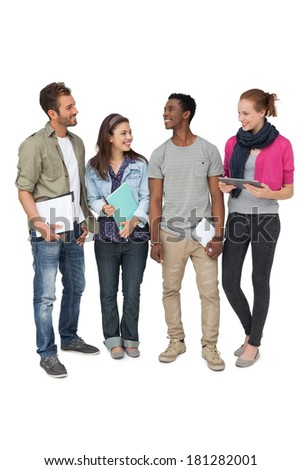 Full length of casual young people with documents and digital table over white background - stock photo