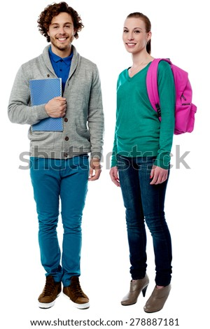 Full length of cheerful classmates posing together - stock photo