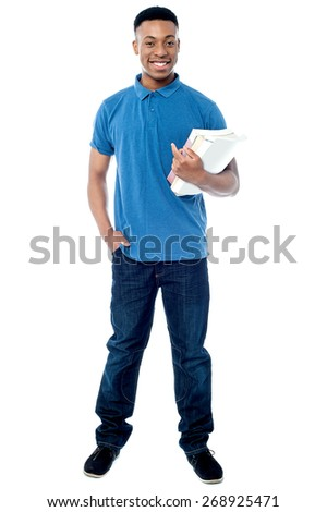 Full length of college student carrying books - stock photo