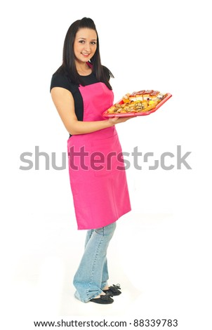 Full length of confectioner in a store holding cakes on plateau isolated on white background - stock photo