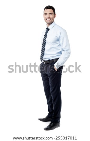 Full length of confident business executive posing - stock photo