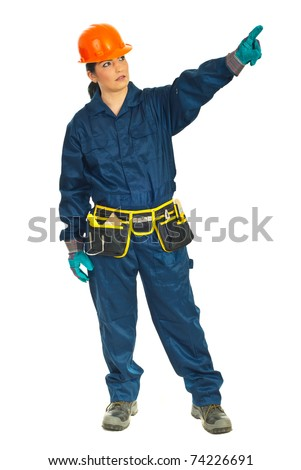 Full length of constructor worker woman pointing away isolated on white background