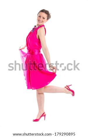 Full length of cute female fashion model posing in pink dress. Isolated on white, studio shot