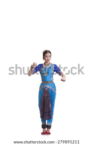Full length of dancer gesturing while performing Bharatanatyam against white background - stock photo