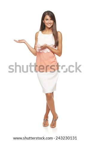 Full length of elegant business woman showing holding on the palm blank copy space over white background - stock photo