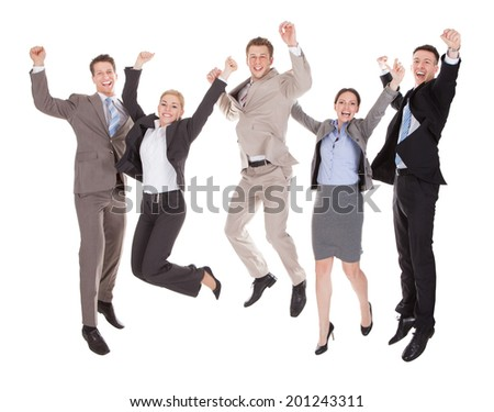 Full length of excited young business people jumping over white background - stock photo