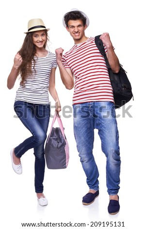 Full length of expressive young couple of tourists gesturing screaming of joy, over white background - stock photo