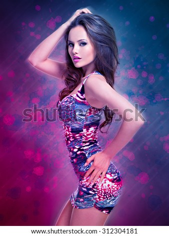full length of fashion model posing in mini skirt.  portrait of a sexy caucasian girl with brown hairs posing on creative  design background