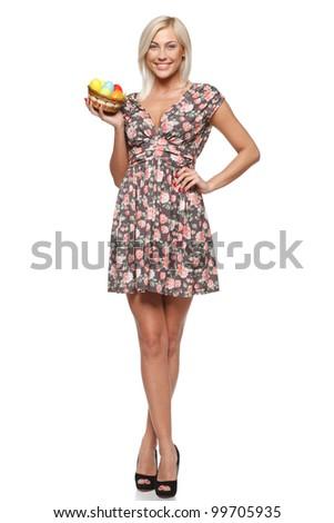 Full length of female fashion model holding basket with Easter eggs, isolated on white background - stock photo