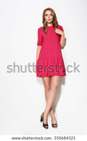 Full length of  female in pink dress posing. Fashion. - stock photo